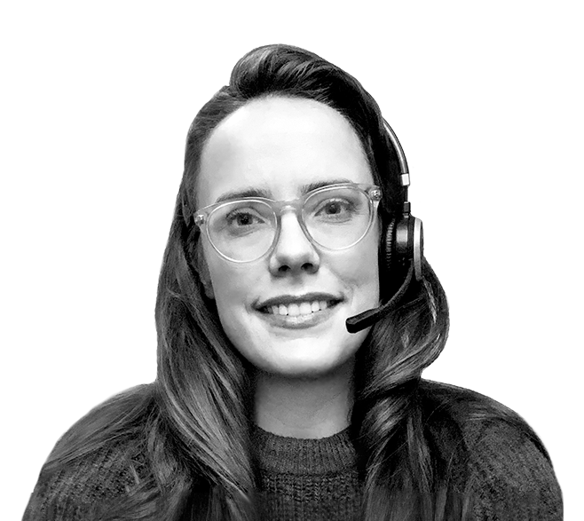 A smiling woman wearing a headset.